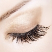 Woman eye with extremely long eyelashes. Delicate pastel shades.